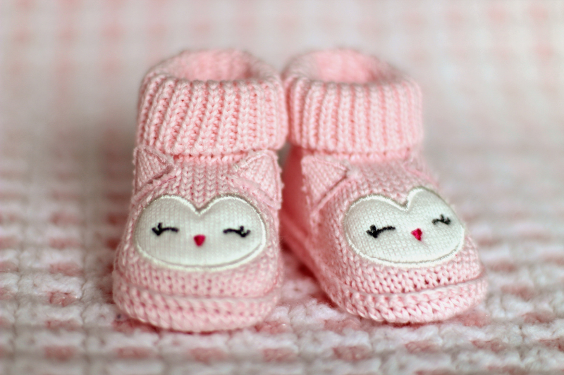 pink knitted baby booties.