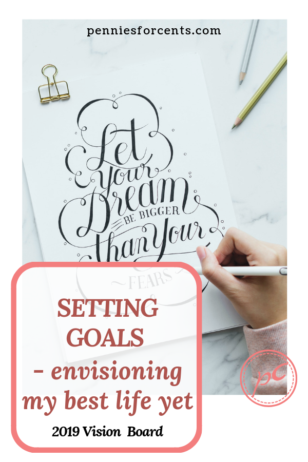 hand with pencil doing calligraphy with text setting goals envisioning your best year