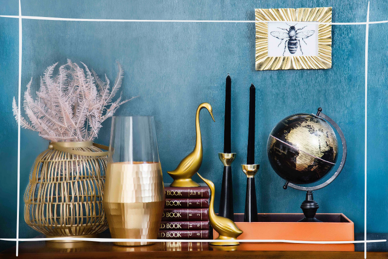 sidetable vignette with gold accessories